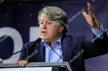 "French lawyer and politician Gilbert Collard speaks at the Convention of the Right, in Paris, . The Convention of the Right, a first ever gathering of rebel representatives of the mainstream right and the far right. Among their goals is to defeat the ""progressives"" of centrist President Emmanuel Macron"