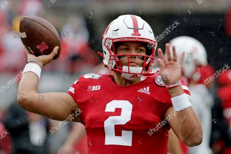 Nebraska quarterback Adrian Martinez (2) warms up before playing an NCAA college football game against Ohio State in Lincoln, Neb