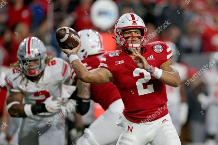 Nebraska quarterback Adrian Martinez (2) throws a pass during the first half of an NCAA college football game against Ohio State in Lincoln, Neb