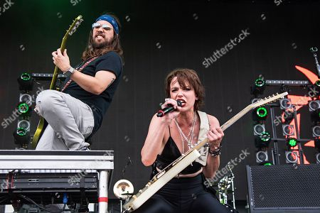 Lzzy Hale Joe Hottinger. Joe Hottinger, left, and Lzzy Hale of Halestorm perform during Louder Than Life at Highland Festival Grounds at KY Expo Center, in Louisville, Ky