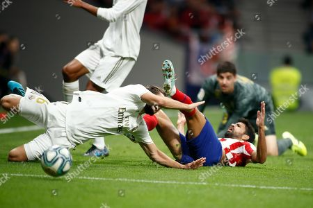 Diego Costa of Atletico de Madrid and Nacho of Real Madrid