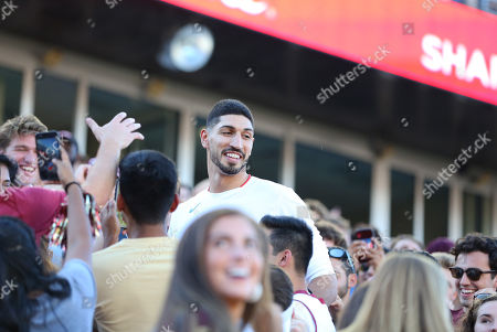 Stock Photo of Chestnut Hill, MA, USA; Boston Celtics center Enes Kanter mingles in the student section during the NCAA football game between Wake Forest Demon Deacons and Boston College Eagles at Alumni Stadium