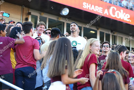 Stock Image of Chestnut Hill, MA, USA; Boston Celtics center Enes Kanter mingles in the student section during the NCAA football game between Wake Forest Demon Deacons and Boston College Eagles at Alumni Stadium