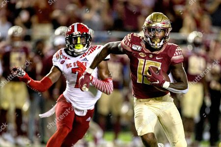 Florida State wide receiver Tamorrion Terry (15) outruns North Carolina State cornerback Chris Ingram (7) to the end zone for a touchdown in the first half of an NCAA college football game in Tallahassee, Fla