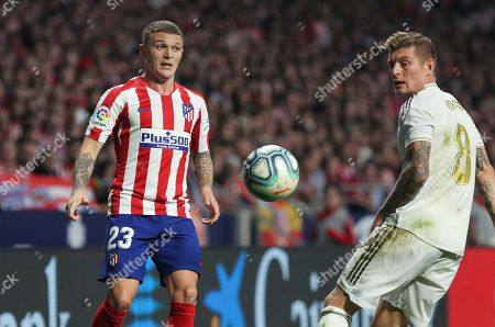 Toni Kroos of Real Madrid and Trippier of Atletico de Madrid