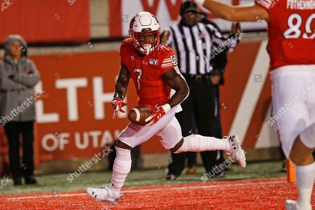 Utah running back Devonta'e Henry-Cole (7) scores against Washington State in the first half of an NCAA college football game, in Salt Lake City