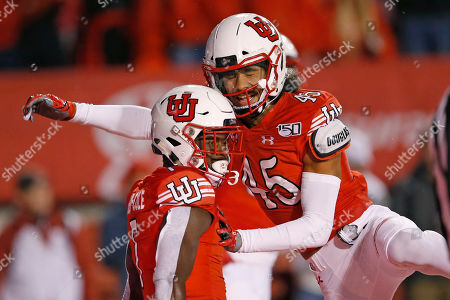 Devonta'e Henry-Cole, Samson Nacua. Utah's Devonta'e Henry-Cole (7) celebrates with teammate Samson Nacua (45) after scoring against Washington State in the first half of an NCAA college football game, in Salt Lake City