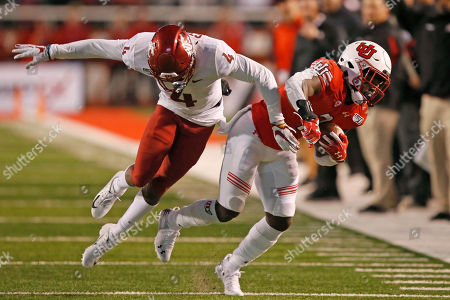 Devonta'e Henry-Cole, Marcus Strong. Utah running back Devonta'e Henry-Cole, right, carries the ball as Washington State cornerback Marcus Strong (4) defends in the second half of an NCAA college football game, in Salt Lake City