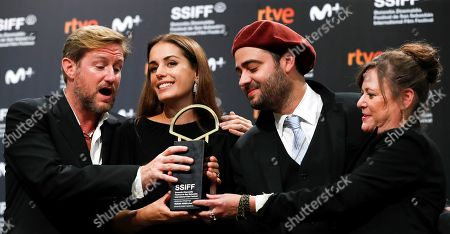 Stock Image of Director Paxton Winters (L), producers Marcos Tellechea (2-R), Paula Linhares (2-L) and Lisa Muskat pose with the Golden Shell award for their film 'Pacified' in San Sebastian, Spain, 28 September 2019 (issued 29 September 2019).