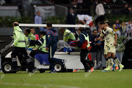 Stock Photo of America's Giovani Dos Santos is carried off the pitch after being injured during a Mexican soccer league match against Guadalajara at Azteca stadium in Mexico City