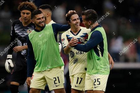 America's Francisco Cordova (17) is congratulated by teammates Henry Martin (21) and Fernando Gonzalez, right, after scoring their side's 2nd goal against Guadalajara during a Mexican soccer league match at Azteca stadium in Mexico City