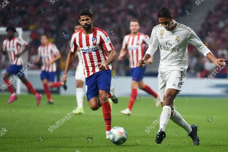 Diego Costa of Atletico de Madrid; Real Madrid's French defender Raphael Varane