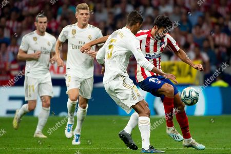 Real Madrid's French defender Raphael Varane; Diego Costa of Atletico de Madrid