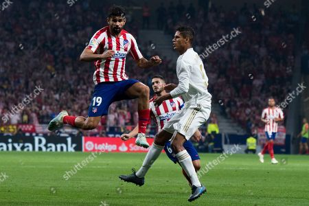 Atletico de Madrid player Diego Costa and Real Madrid player Varane