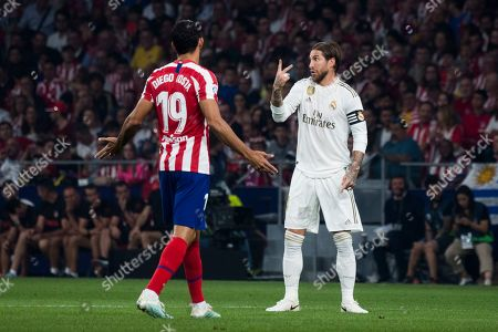 Real Madrid player Sergio Ramos and Atletico de Madrid player Diego Costa