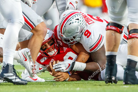 Lincoln, NE. U.S. - Ohio State Buckeyes defensive tackle Jashon Cornell #9 pins Nebraska Cornhuskers quarterback Adrian Martinez #2 to the ground after a tackle in action during a NCAA Division 1 football game between Ohio State Buckeyes and the Nebraska Cornhuskers at Memorial Stadium in Lincoln, NE.. Attendance: 89,759.Ohio State won 48-7