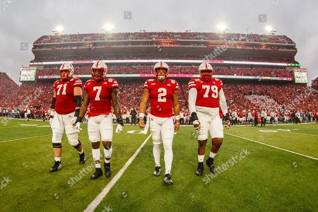 Lincoln, NE. U.S. - Nebraska Cornhuskers four team captains, (L to R) offensive lineman Matt Farniok #71, linebacker Mohamed Barry #7, quarterback Adrian Martinez #2 and defensive lineman Darrion Daniels #79 walk out to the center of the field for the official coin toss before a NCAA Division 1 football game between Ohio State Buckeyes and the Nebraska Cornhuskers at Memorial Stadium in Lincoln, NE.. Attendance: 89,759.Ohio State won 48-7