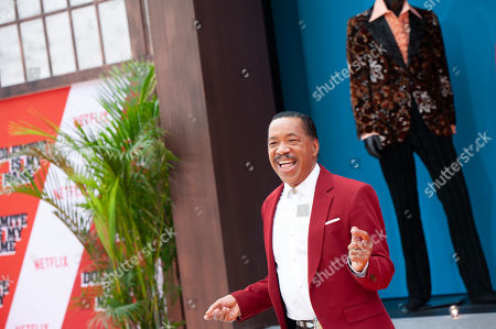 Obba Babatunde (L) dances on the red carpet during the premiere of the Netflix film Dolemite Is My Name at the Regency Village Theatre in Los Angeles, California, USA, 28 September 2019.