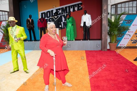 Luenell (C) and hip hop personality Don Magic Juan (L) pose on the red carpet during the premiere of the Netflix film Dolemite Is My Name at the Regency Village Theatre in Los Angeles, California, USA, 28 September 2019.