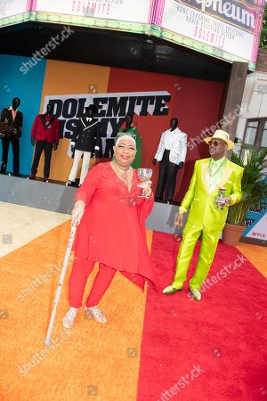 Luenell (L) and hip hop personality Don Magic Juan (R) pose on the red carpet during the premiere of the Netflix film Dolemite Is My Name at the Regency Village Theatre in Los Angeles, California, USA, 28 September 2019.