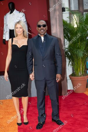 Eddie Murphy (R) and his wife Astralian actor Paige Butcher (L) pose on the red carpet during the premiere of the Netflix film Dolemite Is My Name at the Regency Village Theatre in Los Angeles, California, USA, 28 September 2019.
