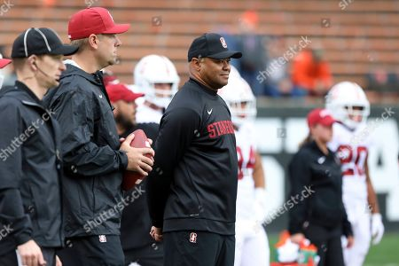 Stanford head coach David Shaw looks on during warm ups prior to an NCAA college football game against Oregon State in Corvallis, Ore., . Stanford won 31-28