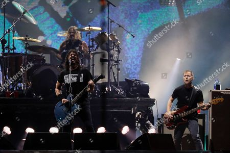 Dave Grohl, left front, of the band Foo Fighters performs at the Rock in Rio music festival in Rio de Janeiro, Brazil, early