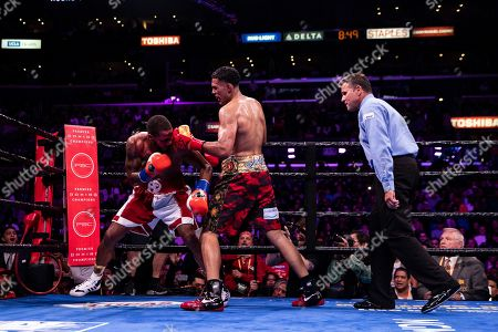 David Benavidez (C) of the USA in action against Anthony Dirrell (L) of the USA during their WBC World Super Middleweight Championship fight at Staples Center in Los Angeles, California, USA, 28 September 2019.