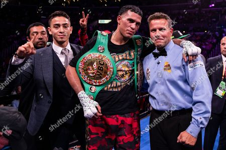 David Benavidez (C) of the USA celebrates after winning against Anthony Dirrell of the USA during a WBC World Super Middleweight Championship fight at Staples Center in Los Angeles, California, USA, 28 September 2019.
