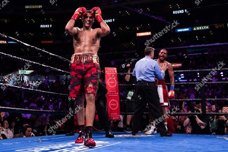 David Benavidez of the US (L) celebrates after winning against Anthony Dirrell (R) of the USA during a WBC World Super Middleweight Championship fight at Staples Center in Los Angeles, California, USA, 28 September 2019.