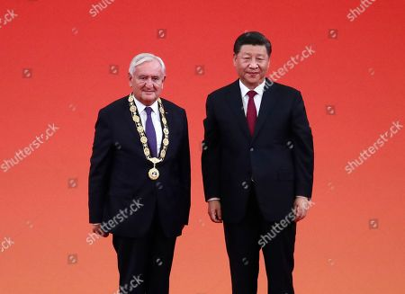 Chinese President Xi Jinping (R) poses for a photo with former French prime minister Jean-Pierre Raffarin after awarding him a Friendship Medal during a presentation ceremony for national medals and national honorary titles at the Great Hall of the People (GHOP) in Beijing, China, 29 September 2019. Chinese President Xi Jinping awarded national medals and honorary titles to individuals who have made great contributions to the country ahead of the 70th anniversary of the founding of the People's Republic of China on 01 October 2019.