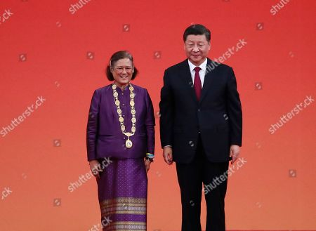 Chinese President Xi Jinping (R) poses for photos with Thai Princess Maha Chakri Sirindhorn after awarding her with a Friendship Medal at a presentation ceremony for national medals and national honorary titles at the Great Hall of the People (GHOP) in Beijing, China, 29 September 2019. Celebrations are being held to mark the 70th anniversary of the founding of the People's Republic of China on 01 October 2019.
