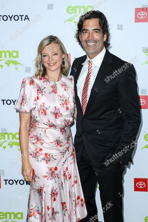 Stock Picture of Amy Smart and Carter Oosterhouse