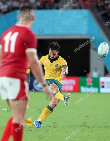 Stock Photo of Australia's Matt Toomua kicks a penalty during the Rugby World Cup Pool D game at Tokyo Stadium between Australia and Wales in Tokyo, Japan