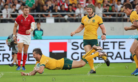 Australia's Adam Ashley-Cooper scores a try during the Rugby World Cup Pool D game at Tokyo Stadium between Australia and Wales in Tokyo, Japan