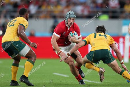 Australia vs Wales. Jonathan Davies of Wales with Australia's Adam Ashley-Cooper and Samu Kerevi