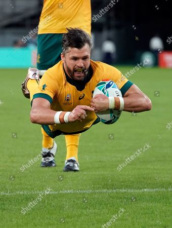 Adam Ashley-Cooper of Australia scores a try during the Rugby World Cup match between Australia and Wales at Tokyo Stadium in Tokyo, Japan, 29 September 2019.