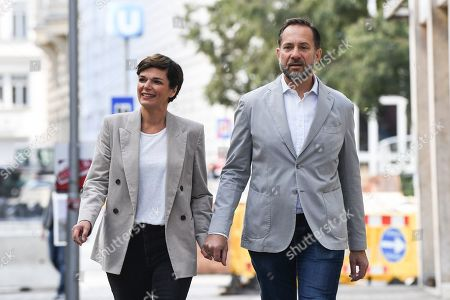 Pamela Rendi-Wagner, leader of Austrian Social Democratic Party (SPOe) and SPOe top candidate, ander husband Michael Rendi arrive at a polling station after casting their votes in the Austrian federal elections in Vienna, Austria, 29 September 2019.