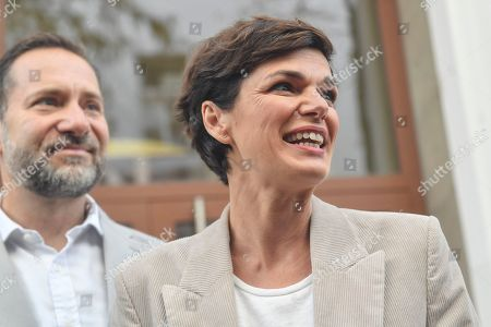 Pamela Rendi-Wagner, leader of Austrian Social Democratic Party (SPOe) and SPOe top candidate, ander husband Michael Rendi leave a polling station after casting their votes in the Austrian federal elections in Vienna, Austria, 29 September 2019.