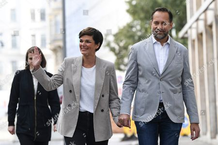 Pamela Rendi-Wagner, leader of Austrian Social Democratic Party (SPOe) and SPOe top candidate, and her husband Michael Rendi arrive at a polling station after casting their votes in the Austrian federal elections in Vienna, Austria, 29 September 2019.