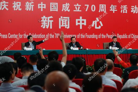 China's Minister of Ecology and Environment Li Ganjie (C) takes questions during a press conference in Beijing, China, 29 September 2019, ahead of the 70th anniversary of the founding of the People's Republic of China on 01 October 2019.