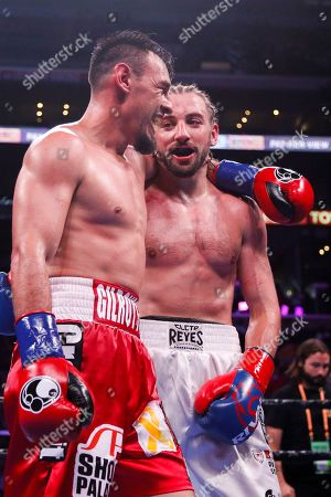 Robert Guerrero greets with Jerry Thomas after the Welterweights boxing match, in Los Angeles