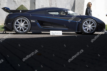 A 2015 Koenigsegg One:1 model car, part of some 25 luxury cars owned by Teodoro Obiang, the son of the Equatorial Guinea's President Teodoro Obiang Nguema Mbasogo before an auction of sales house Bonhams at the Bonmont Abbey Golf & Country Club in Cheserex near Geneva, Switzerland, 29 September 2019. A collection of luxury cars from Equatorial Guinea's vice president Teodorin Obiang Nguema confiscated by the Geneva prosecutor's office after a deal ending a money-laundering inquiry, are auctioned off in Switzerland and are estimated to bring in 18.5 million Swiss francs.