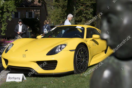 A Porsche 918 Spyder (2015), part of some 25 luxury cars owned by Teodoro Obiang, the son of the Equatorial Guinea's President Teodoro Obiang Nguema Mbasogo before an auction of sales house Bonhams at the Bonmont Abbey Golf & Country Club in Cheserex near Geneva, Switzerland, 29 September 2019. A collection of luxury cars from Equatorial Guinea's vice president Teodorin Obiang Nguema confiscated by the Geneva prosecutor's office after a deal ending a money-laundering inquiry, are auctioned off in Switzerland and are estimated to bring in 18.5 million Swiss francs.