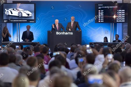 Two auctioneers award the Lamborghini Veneno Roadster (2014) sport car for 7,200,000 Swiss Francs, part of some 25 luxury cars owned by Teodoro Obiang, the son of the Equatorial Guinea's President Teodoro Obiang Nguema Mbasogo during an auction of sales house Bonhams at the Bonmont Abbey Golf & Country Club in Cheserex near Geneva, Switzerland, 29 September 2019. A collection of luxury cars from Equatorial Guinea's vice president Teodorin Obiang Nguema confiscated by the Geneva prosecutor's office after a deal ending a money-laundering inquiry, are auctioned off in Switzerland and are estimated to bring in 18.5 million Swiss francs.