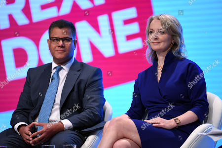 Britain's Secretary of State for International Development Alok Sharma (L) and Secretary of State for International Trade Liz Truss (R) speaks at the Conservative Party Conference in Manchester, Britain, 29 September 2019. The Conservative Party Conference runs from 29 September to 02 October 2019.