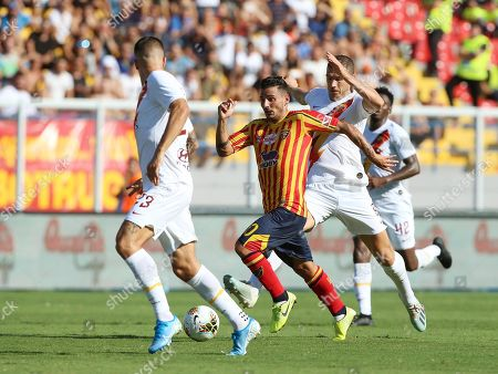 Lecce's Filippo Falco (C) contrastated by Roma's Gianluca Mancini (L) and Edin Dzeko during the Italian Serie A soccer match US Lecce vs AS Roma at the Via del Mare stadium in Lecce, Italy, 29 September 2019.
