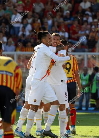 Stock Image of Roma's Edin Dzeko (C) jubilates with his teammates after scoring during the Italian Serie A soccer match US Lecce vs AS Roma at the Via del Mare stadium in Lecce, Italy, 29 September 2019.