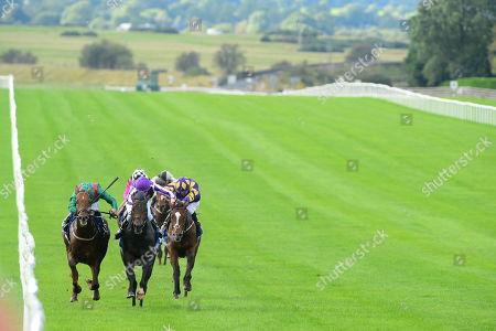 CURRAGH. INNISFREE and Donnacha O'Brien (centre,purple) win The Beresford Stakes for trainer Aidan O'Brien from SHEKHEM (left,green).