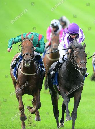 CURRAGH. INNISFREE and Donnacha O'Brien (right) win The Beresford Stakes for trainer Aidan O'Brien from SHEKHEM (left,green).